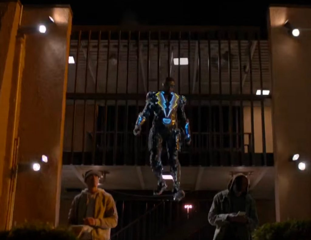 Black Lighting leaping from a balcony